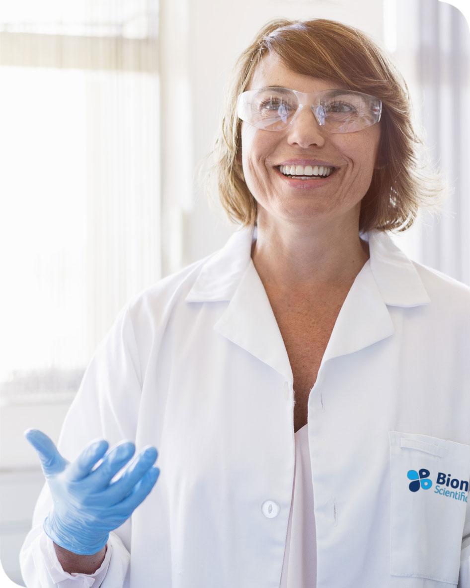 Biologics CDMO scientist wearing Bionova lab coat.